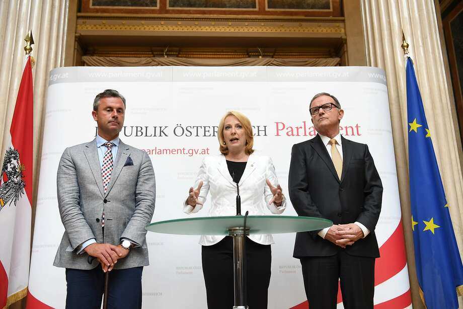 President of the National Council Doris Bures (C), Deputy President of the National Council Karlheinz Kopf (R) and the third President of the National Council Norbert Hofer (L) attend a press conference, on July 1, 2016, in Vienna.  Austria's highest court on July 1 annulled May's presidential election result following a legal challenge from the far-right Freedom Party (FPOe), whose candidate lost by a narrow margin, citing irregularities.  / AFP PHOTO / APA / HELMUT FOHRINGER / Austria OUTHELMUT FOHRINGER/AFP/Getty Images Photo: HELMUT FOHRINGER, AFP/Getty Images