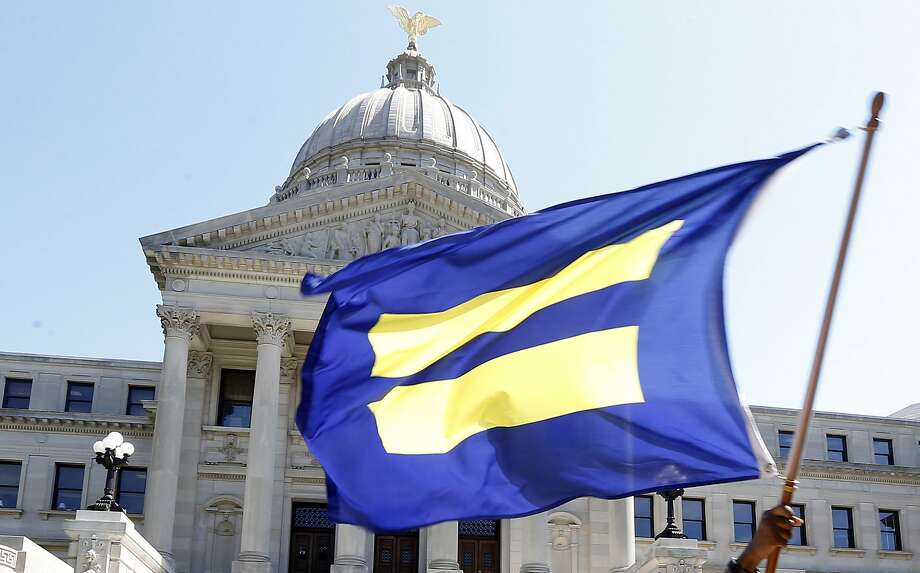 The flag of the Human Rights Campaign — the largest national LGBT civil rights organization — is waved at the state Capitol in Jackson, Miss. Photo: Rogelio V. Solis, Associated Press