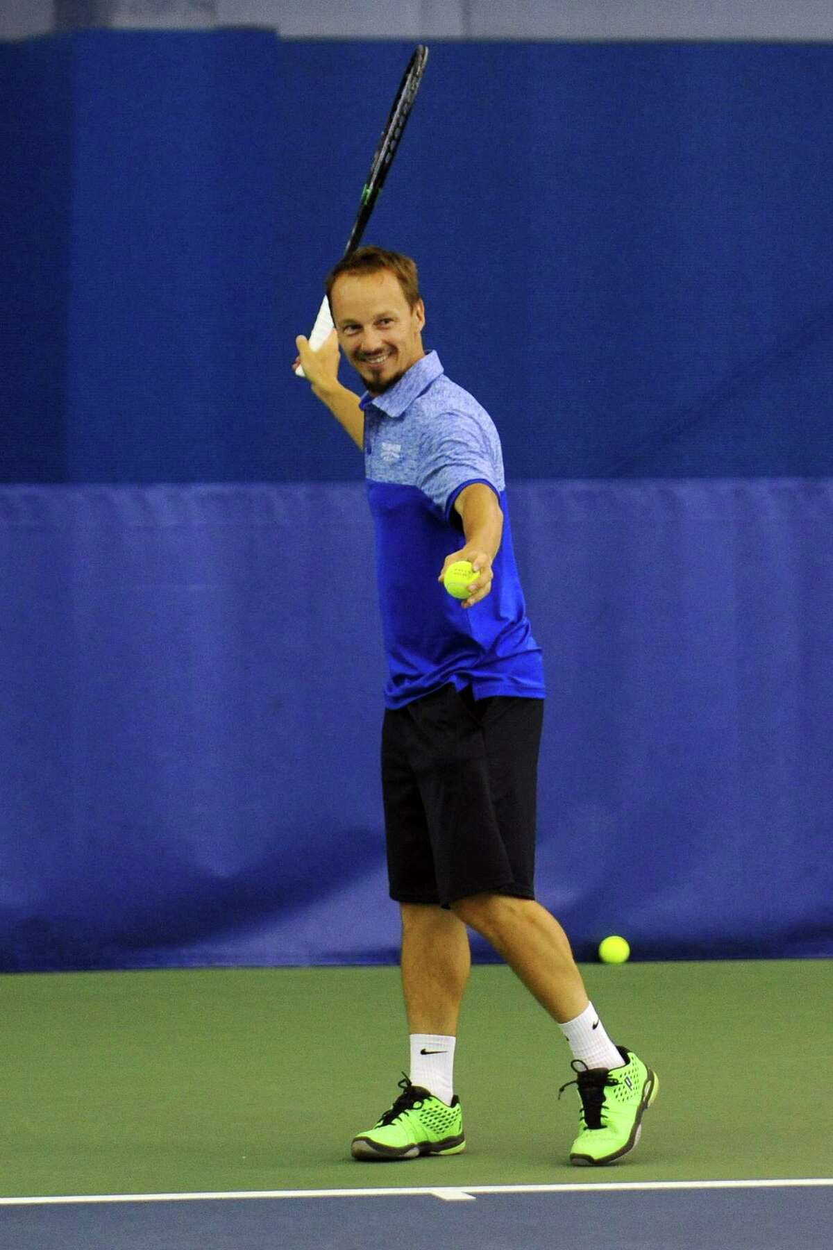 Radoslaw Szymanik, a tennis pro at Chelsea Piers in Stamford, hits a forehand while rallying with another tennis pro at Chelsea Piers on Thursday, June 30, 2016. Szymanik will be a coach on Poland's Summer Olympics tennis team.