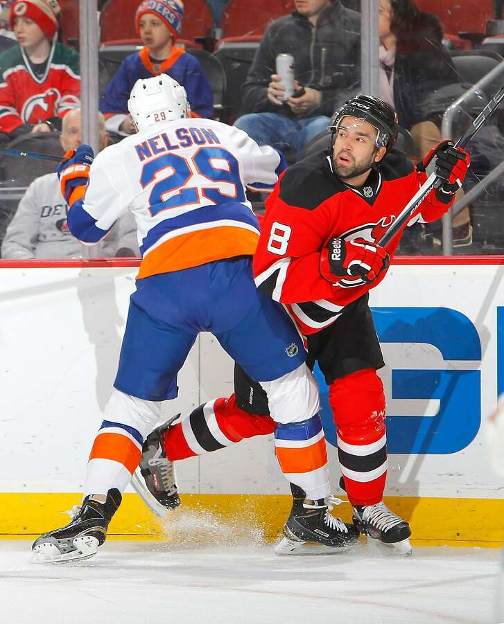 NEWARK, NJ - FEBRUARY 19:  David Schlemko #8 of the New Jersey Devils tries to avoid a check from Brock Nelson #29 of the New York Islanders in the first period at the Prudential Center on February 19, 2016 in Newark, New Jersey.  (Photo by Jim McIsaac/Getty Images)