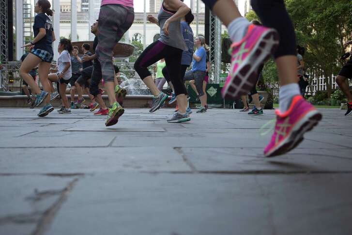 "An early morning fitness group works out at Bryant Park in New York last month. . Researchers believe that exercise improves brains in part by goosing the body's production of a substance called brain-derived neurotrophic factor, or BDNF, which is a protein that scientists sometimes refer to as ""Miracle-Gro"" for the brain."