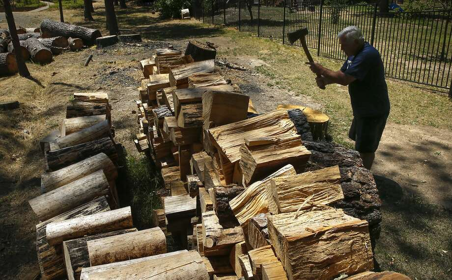 Bill Harsh has stacks of wood salvaged from dying trees on his property in Mariposa. Photo: Michael Macor, The Chronicle