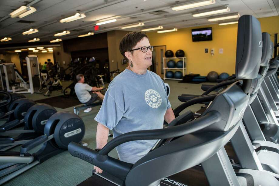 Linda Guinee, a survivor of breast cancer who was part of a weight loss clinical trial, exercises at a gym in Boston, June 24, 2016. Scientists are recruiting thousands of women for a large clinical trial to find out if weight loss should be prescribed as a treatment for breast cancer. Photo: SHIHO FUKADA / NYT / NYTNS