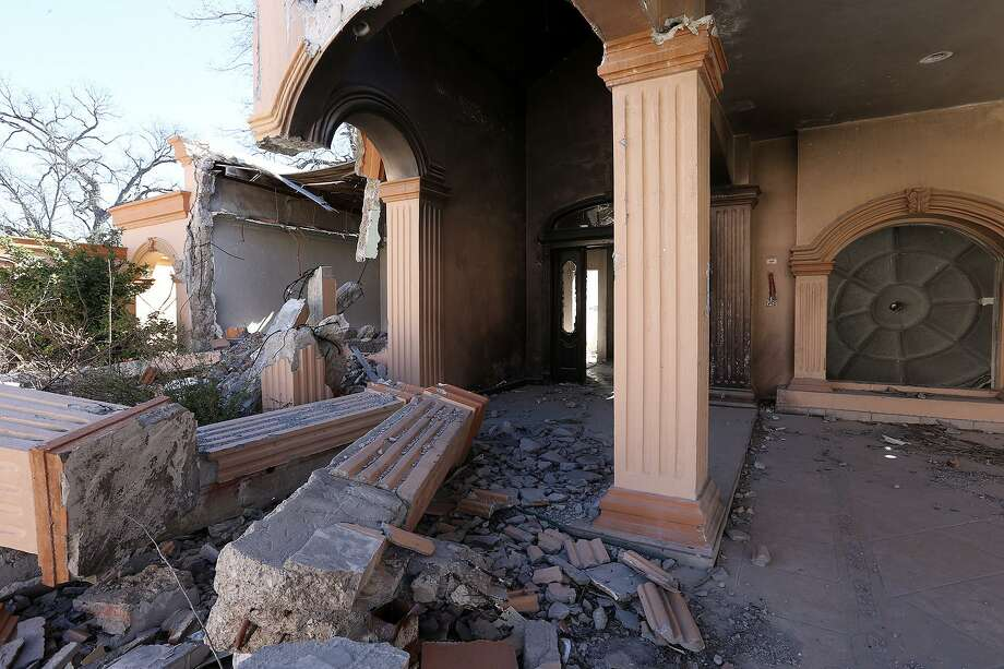 A burned-out house lies in ruins in the the town of Allende, Mexico, Tuesday, Jan. 27, 2015. Allende is a small town west of Piedras Negras, Mexico and is the site of a massacre by the drug cartel, Los Zetas. Photo: JERRY LARA, Staff / San Antonio Express-News / © 2015 San Antonio Express-News