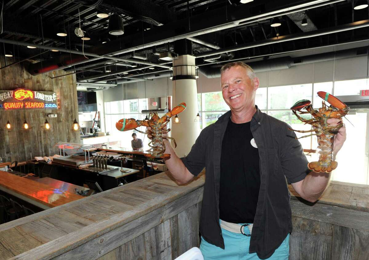 Boothbay Lobster Company co-owner David Galin with two Boothbay lobsters in his restaurant and bar that will be opening soon at 14 Harbor Point Road in Stamford.