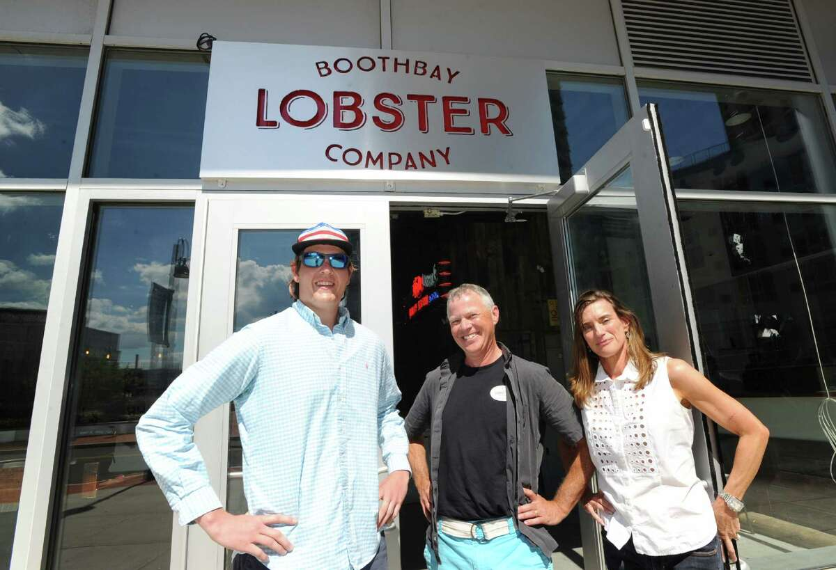 Boothbay Lobster Company co-owners Willie Craig, left, and David Galin, center, with their general manger Kim Crosby, right, in front of their seafood restaurant and bar that will be opening soon at 14 Harbor Point Road, Stamford, Conn., as seen Thursday, June 30, 2016.