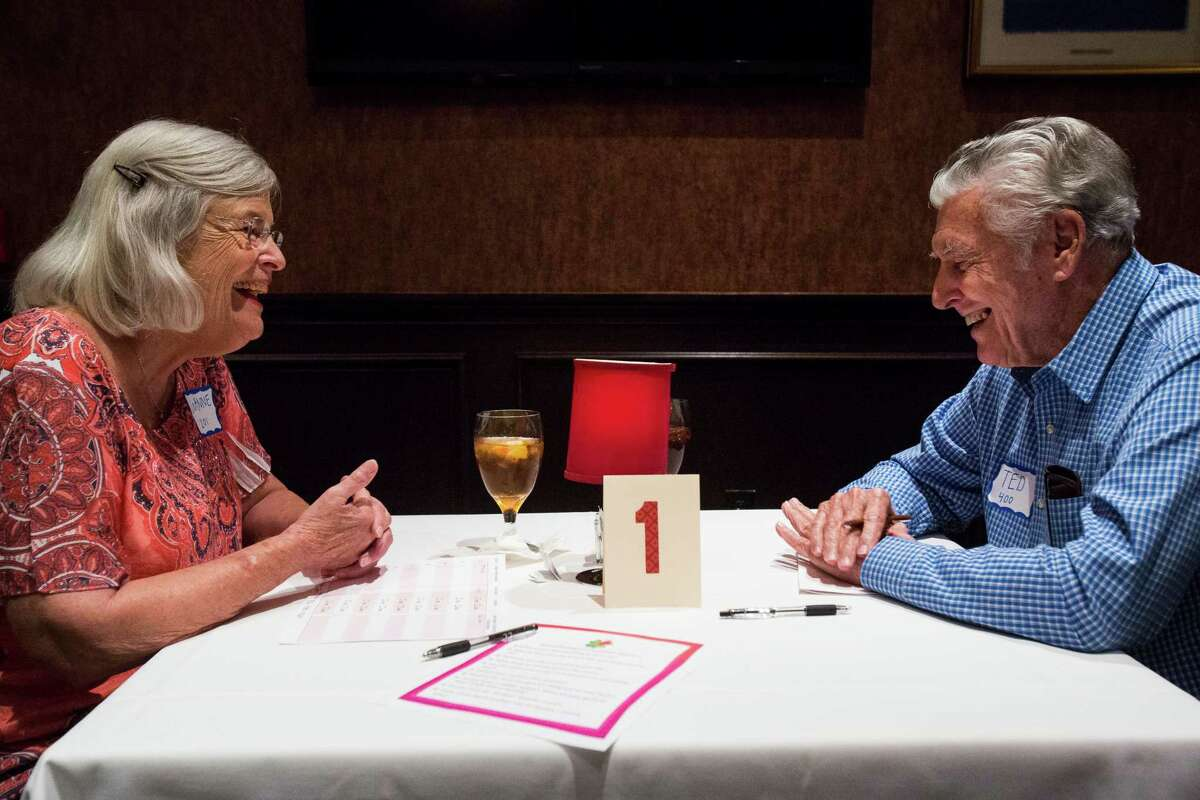 Joanne Hale, 76, and Ted Eckhardt, 83, laugh together during their five minute date at senior speed dating event at Bob's Chop and Steakhouse in San Antonio, on Wednesday, June 22, 2016.
