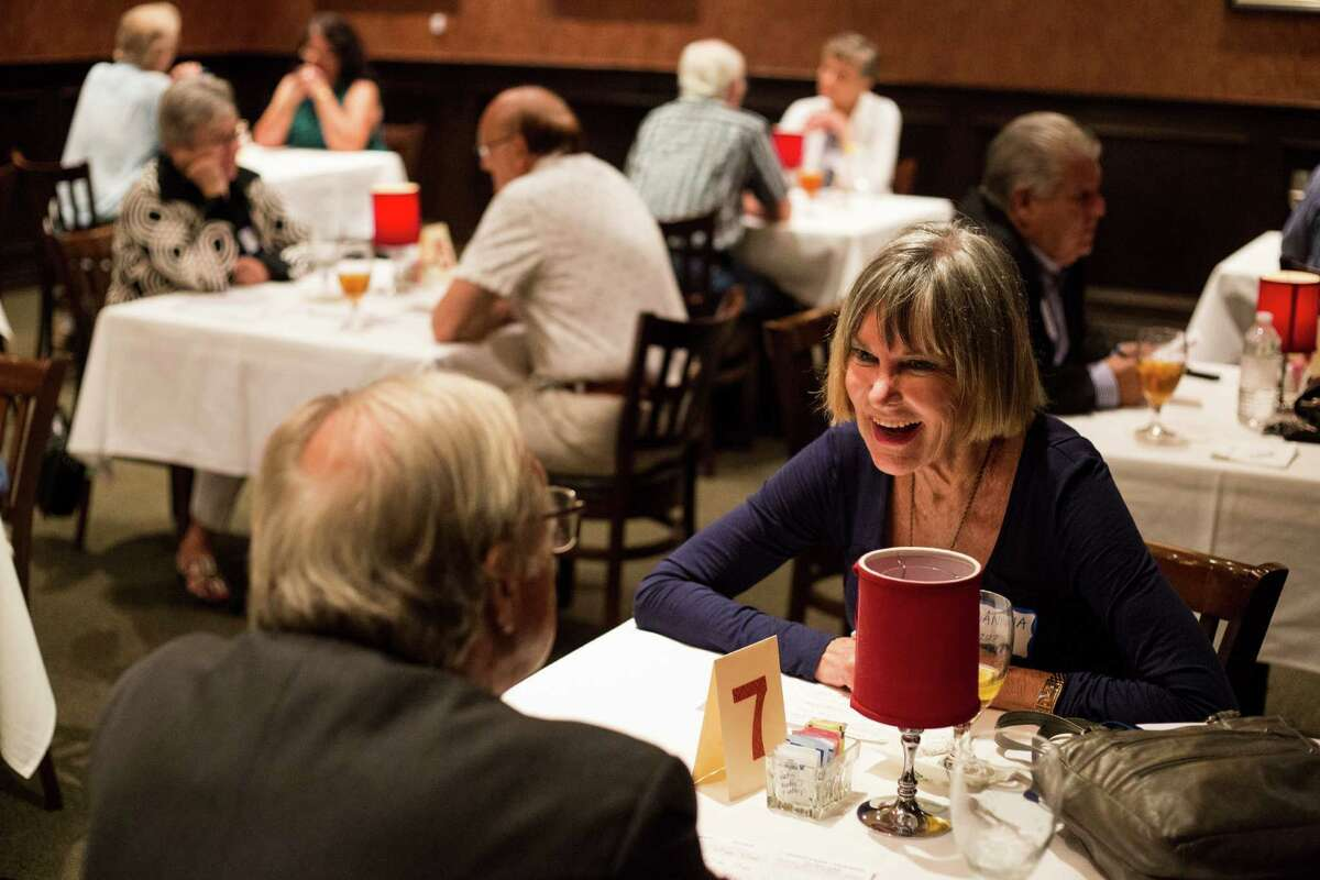 Joanna Holloway of San Antonio laughs with her date during a senior speed dating event at Bob's Chop and Steakhouse in San Antonio, on Wednesday, June 22, 2016.