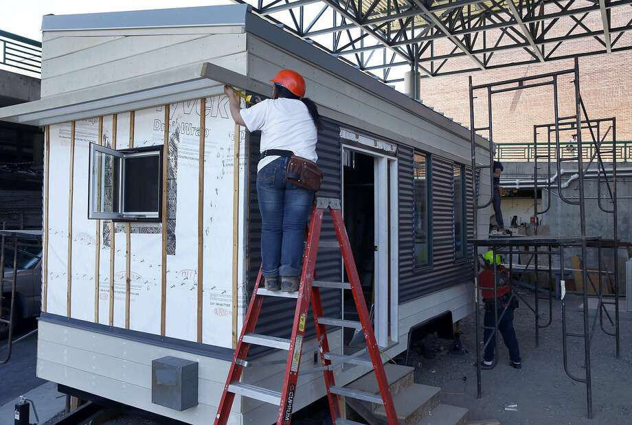 Carpentry students build a tiny home for a design competition at Laney College in Oakland. The City Council has awarded an $80,000 grant to the college's carpentry program to design a tiny home prototype. Photo: Paul Chinn, The Chronicle