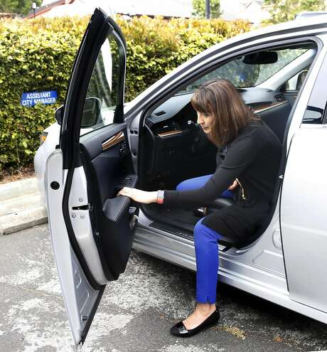 Assistant city manager Julie Underwood volunteered for a pilot program to have electric car drivers measure their mileage on her Lexus hybrid's odometer on Friday, July 1, 2016, in Daly City, Calif. Photo: Liz Hafalia, The Chronicle