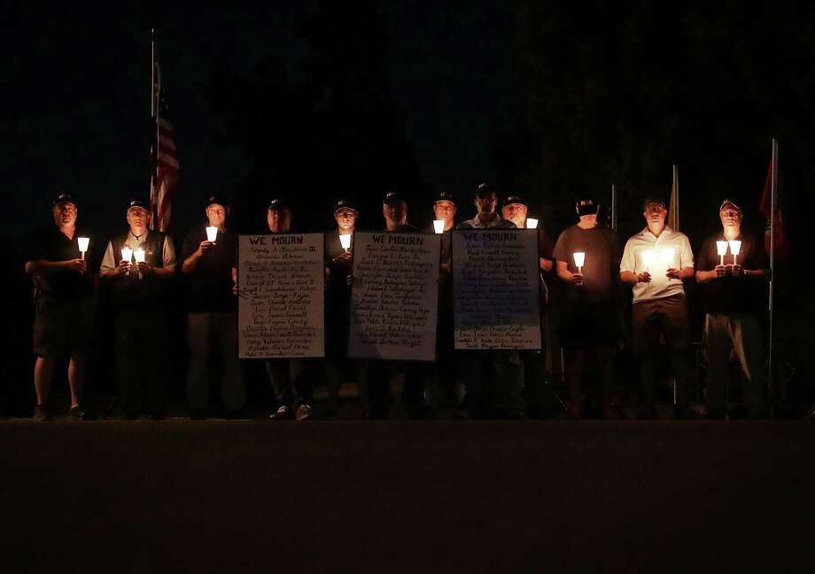 A group of National Rifle Association members participate in a counter-vigil, not far away from a gun control demonstration, in Fairfax, Virginia. A reader says the reason gun control legislation failed following the massacre in Orlando, Florida, is because of the effective lobbying efforts of the NRA. Photo: Alex Wong /Getty Images / 2016 Getty Images