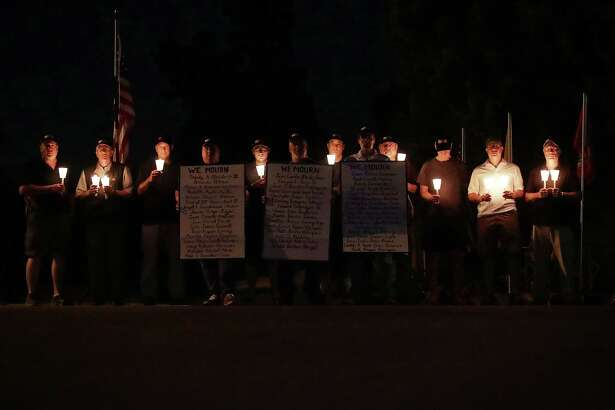 A group of National Rifle Association members participate in a counter-vigil, not far away from a gun control demonstration, in Fairfax, Virginia. A reader says the reason gun control legislation failed following the massacre in Orlando, Florida, is because of the effective lobbying efforts of the NRA.