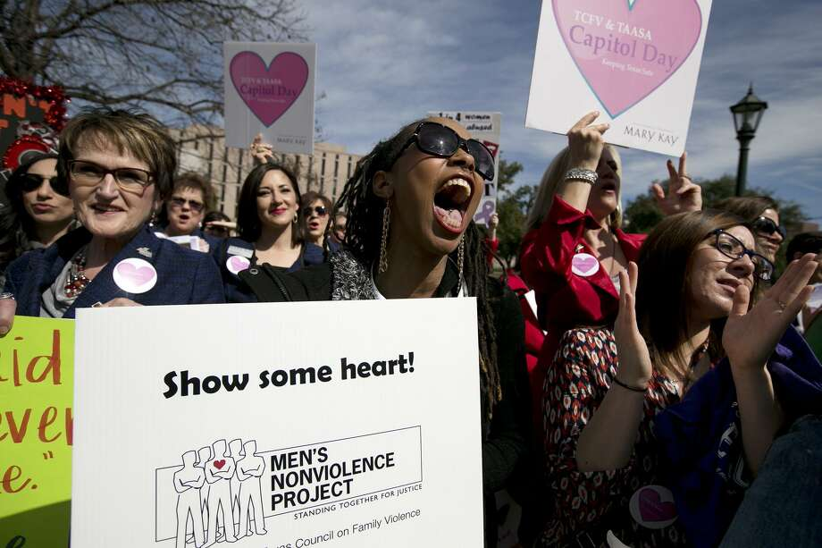 Demonstrators urge more funding for domestic violence and sexual assault programs in 2015. The need is still great for the Texas Legislature to fund the programs that aid survivors. Photo: Deborah Cannon /Associated Press / Austin American-Statesman