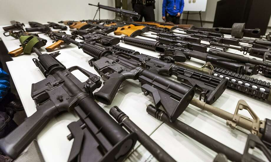 A variety of military-style semiautomatic rifles obtained during a buyback program are displayed at Los Angeles police headquarters. Photo: Damian Dovarganes, Associated Press