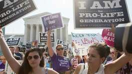 For some, the Supreme Court is the paramount issue in this campaign, allowing them to ignore Donald Trump's flaws. Abortion is key among the issues concerning them. Pro-abortion rights and anti-abortion protesters rally in front of the U.S. Supreme Court in Washington, June 27.