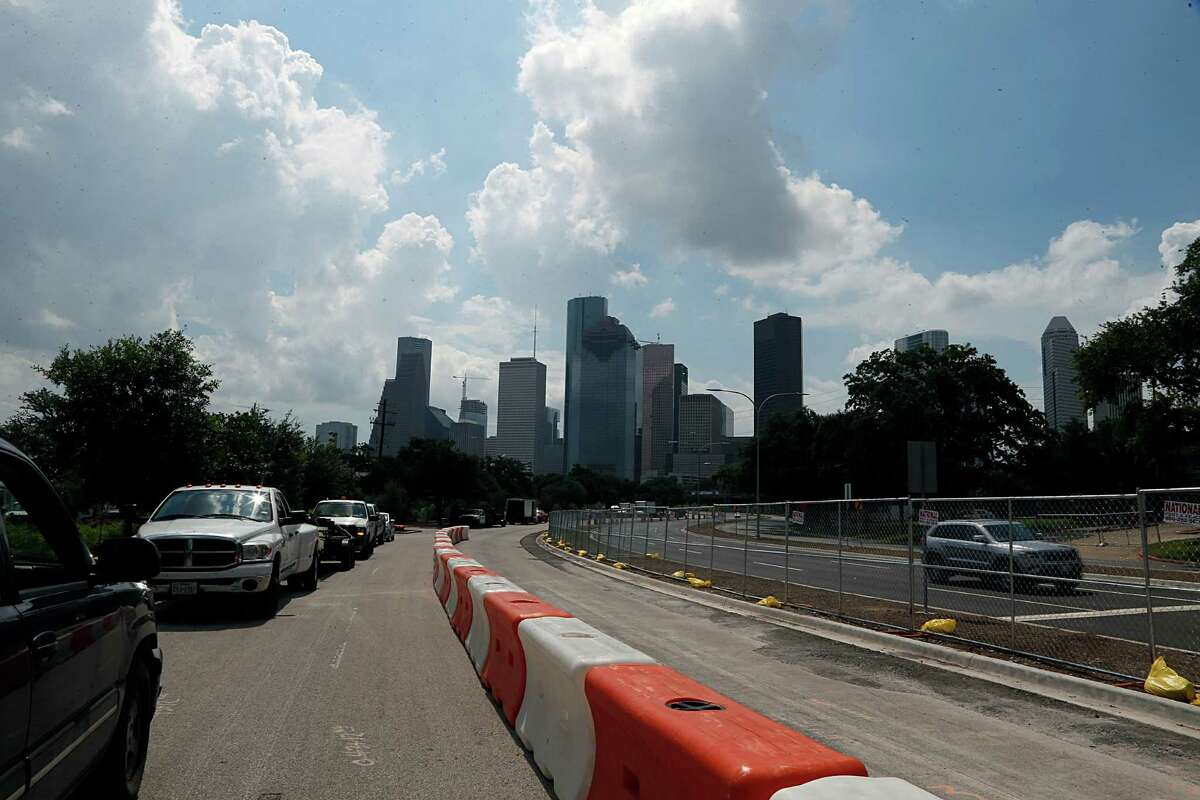 The former westbound lanes of Allen Parkway will be converted to 141 metered parking spaces after improvements are completed to the Buffalo Bayou Park area by late September. As of July 1, shown above, traffic is already on the new lanes.