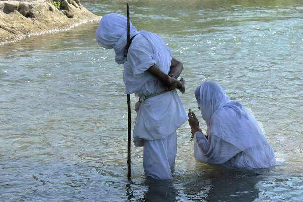 Azita Ebad is baptized on Sept. 26. The Mandaeans believe they can only perform their baptisms in living water, like a river or a spring.