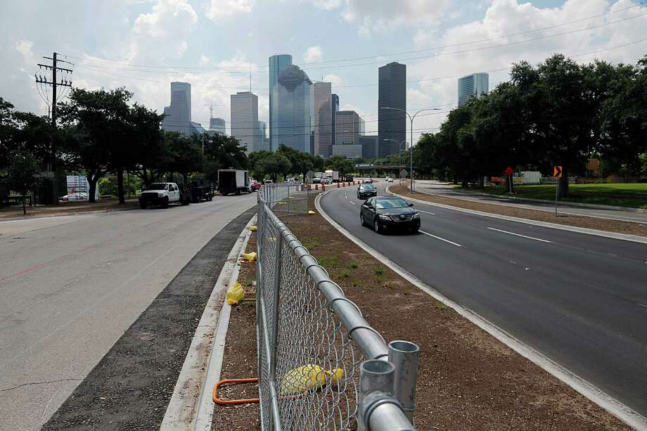The former west bound lanes left, of Allen Parkway which will be converted to 141 metered parking spaces after improvements are completed to the Buffalo Bayou Park, seen on July 1. Photo: James Nielsen, Houston Chronicle / © 2016  Houston Chronicle