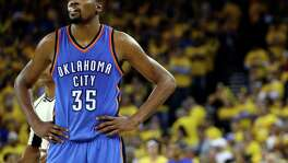 Oklahoma City Thunder's Kevin Durant watches during the closing minutes of the second half in Game 5 of the Western Conference finals against the Golden State Warriors in Oakland, Calif., on May 26, 2016.