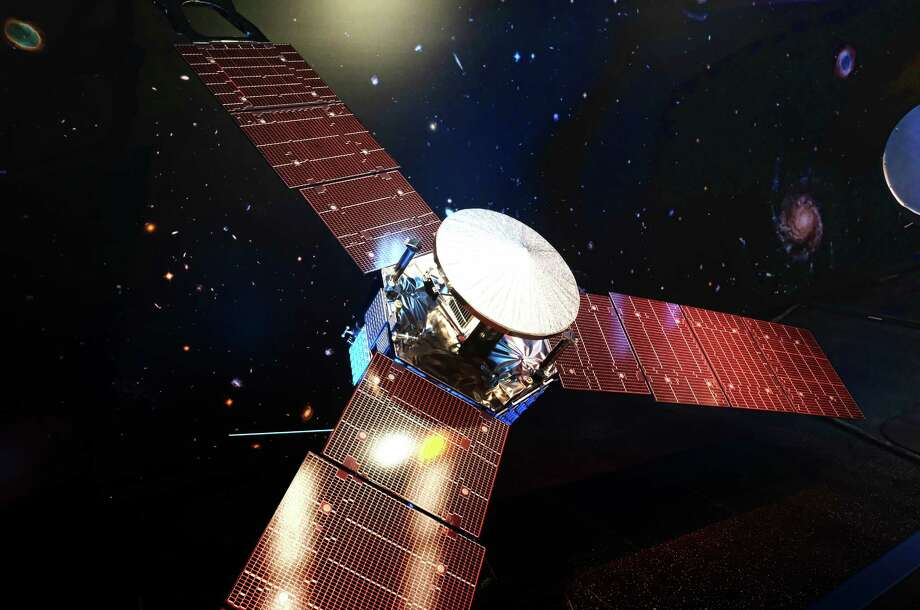 A 1/5 scale model size of NASA's solar-powered Juno spacecraft is displayed at the Jet Propulsion Laboratory in Pasadena, Calif. on Friday, July 1, 2016. The spacecraft is on the final leg of a five-year, 1.8 billion-mile voyage to the biggest planet in the solar system. It's expected to reach Jupiter and go into orbit around the planet on July 4. (AP Photo/Richard Vogel) Photo: Richard Vogel, Associated Press / Copyright 2016 The Associated Press. All rights reserved. This material may not be published, broadcast, rewritten or redistribu