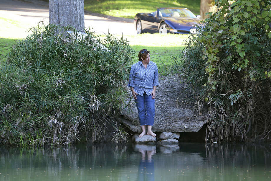 Stacey Scott takes a look upstream from the Comal River access lot in the GuadaComa subdivision in New Braunfels last year. A judge this week dismissed her suit against the city of New Braunfels, which she filed to stop police from using the lot to launch patrol boats. Photo: TOM REEL /SAN ANTONIO EXPRESS-NEWS / 2015 SAN ANTONIO EXPRESS-NEWS