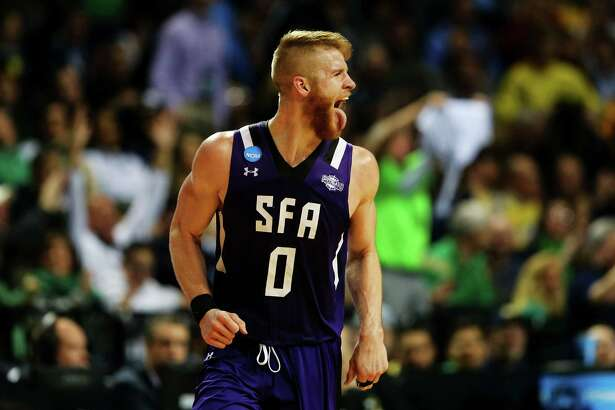 NEW YORK, NY - MARCH 18:  Thomas Walkup #0 of the Stephen F. Austin Lumberjacks reacts in the second half against the West Virginia Mountaineers during the first round of the 2016 NCAA Men's Basketball Tournament at Barclays Center on March 18, 2016 in the Brooklyn borough of New York City.