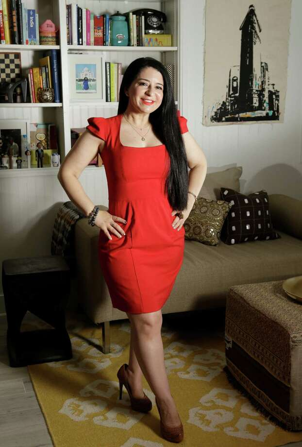 Patty Fadhouli, director of marketing for Abel Design Group, significantly downsized her clothing and accessories after leaving Houston in 2014. Photo: Melissa Phillip, Staff / © 2016 Houston Chronicle
