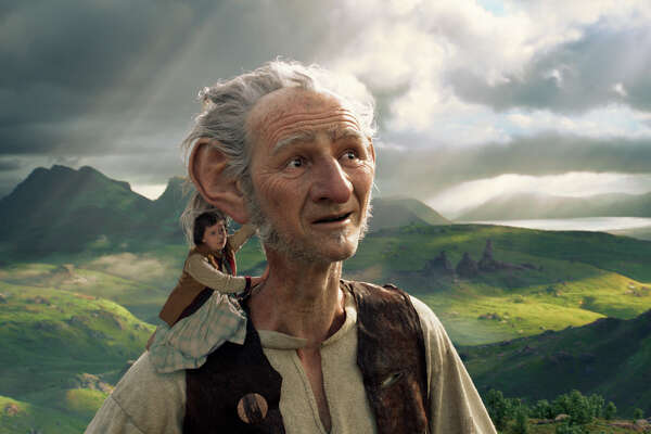 "Ruby Barnhill and the Big Friendly Giant from Giant Country, voiced by Mark Rylance, in a scene from ""The BFG,"" one of the standout movies of the season, combining some lovely acting with extraordinary special effects."