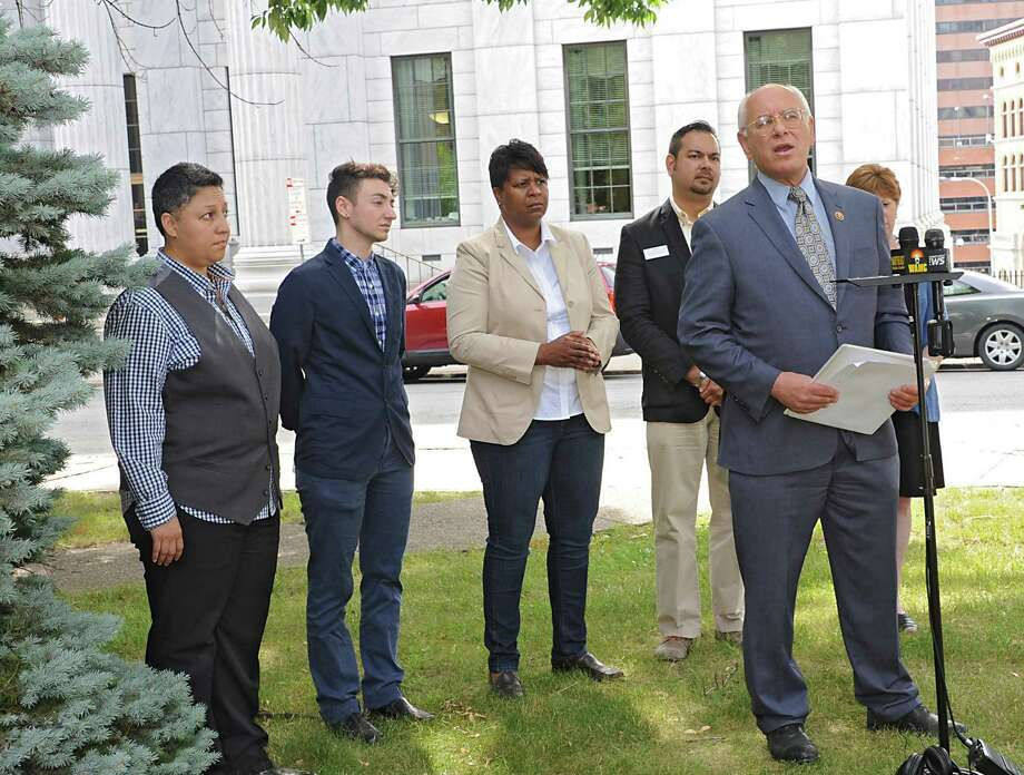 Congressman Paul Tonko, at microphone stand, and local LGBT leaders hold a press conference to discuss recent victories in the campaign for equality and the challenges that still exist before the community in Academy Park on Friday, July 1, 2016 in Albany, N.Y.  (Lori Van Buren / Times Union) Photo: Lori Van Buren / 20037170A