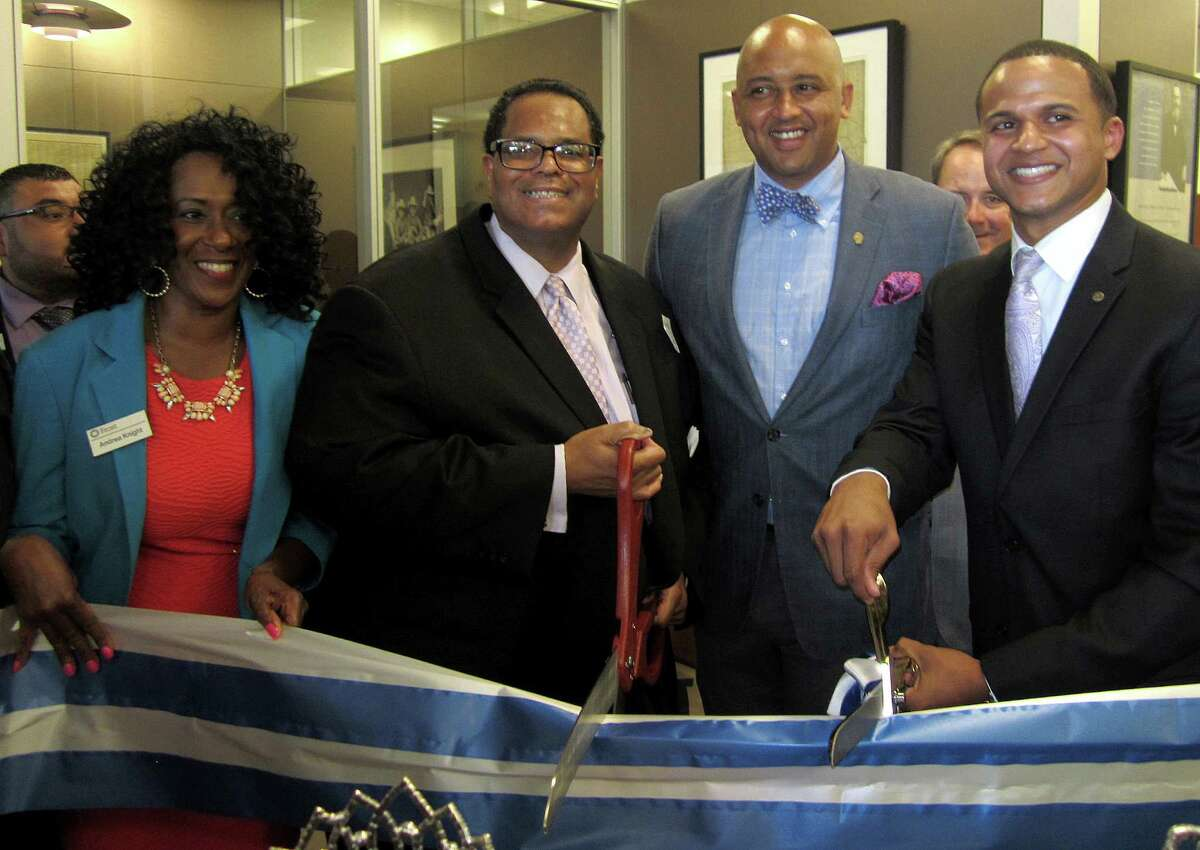 """Left to right, Frost branch manager Andy Knight, Neighborhoods First Alliance President Tommy """"T.C."""" Calvert, District 2 Councilman Alan Warrick and Micah Salinas, Frost Bank market manager, mark the June 23 grand opening of the bank's first branch on the East Side."""