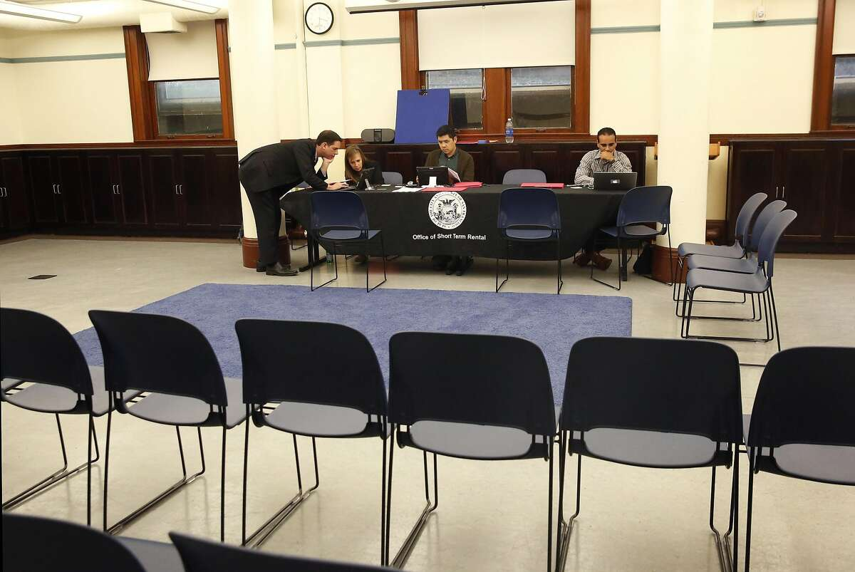 Staffers, from left, Kevin Guy, Director, Audrey Butkus, Planner, Adrian Putra, Planner, and Omar Masry, Senior Administrative Analyst, wait for people to arrive during a public information workshop held by San Francisco's Office of Short-Rent Rentals for vacation-rental hosts to learn about their registration requirement with the city in the Presidio Branch Library June 28, 2016 in San Francisco, Calif.