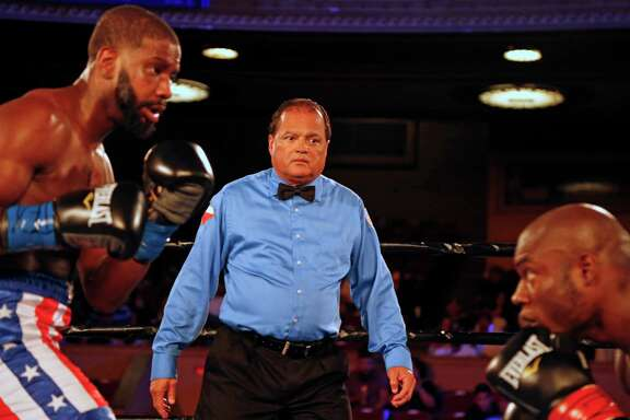 Referee Raphael Ramos, from San Antonio, watches Rynell Riley (right) and Tommy Kamara during their super middleweight fight on Saturday, June 25, 2016 at the Scottish Rite Auditorium.