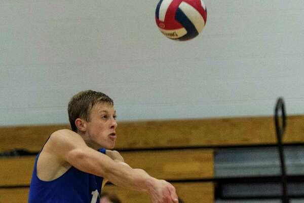 Darien High School's Tim Herget returns a serve during a CIAC quarterfinal boys volleyball match against Cheshire High School played at Darien High School, Darien, CT on Friday, June 3, 2016.