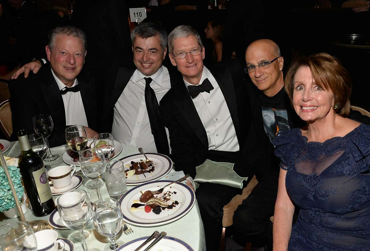 LOS ANGELES, CA - FEBRUARY 07: (L-R) Former Vice President of the United States Al Gore, Apple's SVP of Internet Software and Services, Eddy Cue, CEO of Apple Tim Cook, music producer Jimmy Iovine and Minority Leader of the United States House of Representatives, Nancy Pelosi attend the Pre-GRAMMY Gala and Salute to Industry Icons honoring Martin Bandier at The Beverly Hilton Hotel on February 7, 2015 in Los Angeles, California. (Photo by Lester Cohen/WireImage)