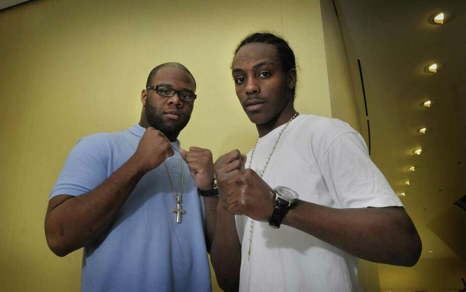 "Boxers Trevor Bryan, left, and Amir Imam pose for a photograph at the Empire State Plaza on Thursday afternoon, May 5, 2011 in Albany.  The two boxers, who are Olympic hopefuls, will fight  opponents as part of the ""Spring Fever Fight Night at the Plaza"" that will take place on Thursday, May 12, 2011.   (Paul Buckowski / Times Union) Photo: Paul Buckowski / 00013020A"