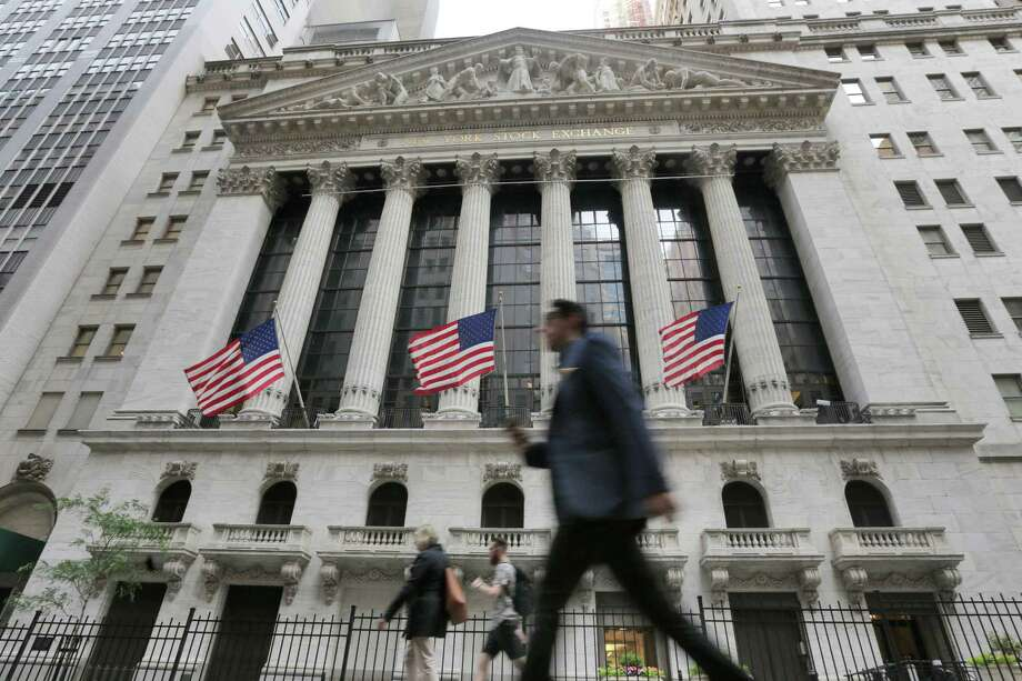 FILE - In this Friday, June 24, 2016, file photo, people walk by the New York Stock Exchange. Global stocks mostly rose Friday, July 1, as authorities stepped in to ease the uncertainty surrounding the British vote to leave the European Union. Investors flocked to equities in the face of narrowing choices for investments amid low or negative interest rates on many bonds. (AP Photo/Richard Drew, File) ORG XMIT: NYBZ507 Photo: Richard Drew / Copyright 2016 The Associated Press. All rights reserved. This m