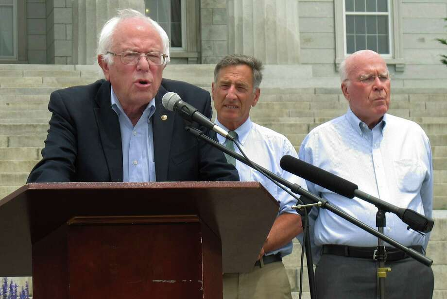 Democratic presidential candidate Sen. Bernie Sanders, left, speaks alongside Gov. Peter Shumlin, center, and Sen. Patrick Leahy at a rally Friday, July 1, 2016 in Montpelier, Vt., held to commemorate the implementation of the nation's first state law to require the labeling of foods made with genetically modified ingredients. (AP Photo/Wilson Ring) ORG XMIT: RPWR105 Photo: Wilson Ring / Copyright 2016 The Associated Press. All rights reserved. This m