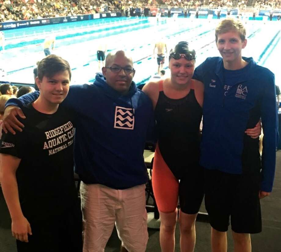 Swimmers from left to right AJ Bornstein, Head Coach Emmanuel Lanzo, Marcie Maguire, Kieran Smith