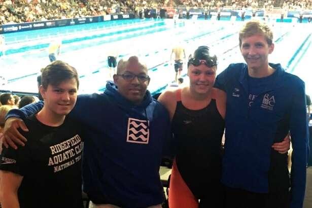Swimmers from left to right AJ Bornstein, Head Coach Emmanuel Lanzo, Marcie Maguire, Kieran Smith