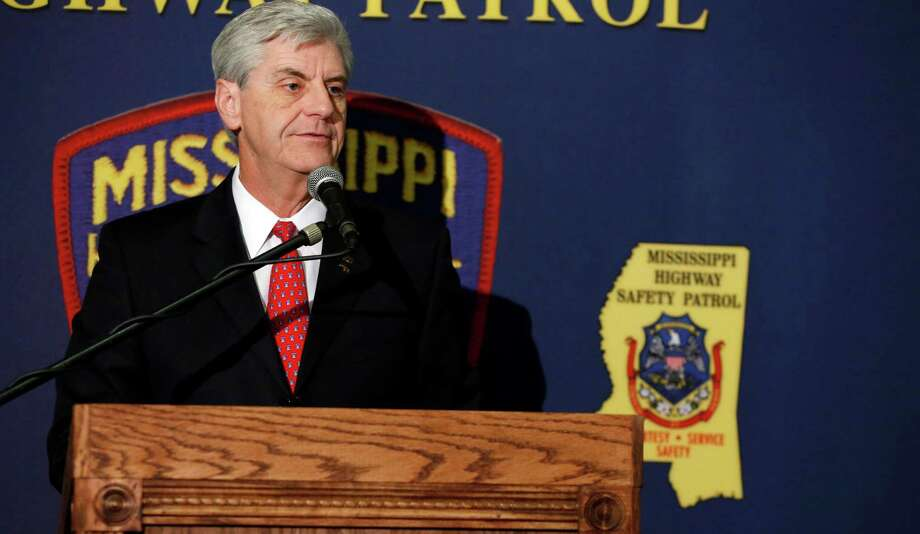 FILE - In this May 17, 2016 file photo, Gov. Phil Bryant  addresses the people gathered during the 2016 Fallen Officers memorial Service at the Mississippi Department of Public Safety headquarters in Jackson, Miss.  A federal judge blocked a Mississippi law on religious objections to same-sex marriage moments before it was set to take effect Friday, July 1, 2016, ruling it unconstitutionally establishes preferred beliefs and creates unequal treatment for gay people.  (AP Photo/Rogelio V. Solis, file) Photo: Rogelio V. Solis, STF / Copyright 2016 The Associated Press. All rights reserved. This material may not be published, broadcast, rewritten or redistribu