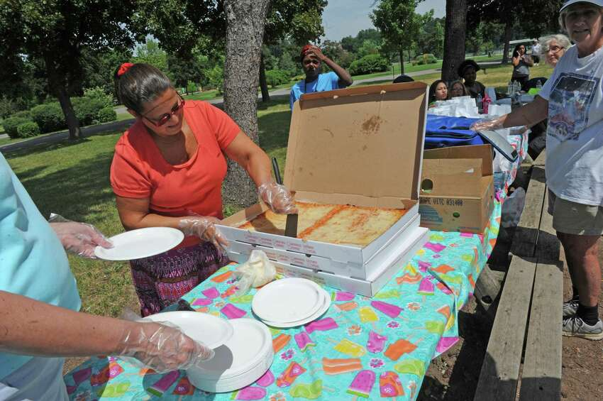 Georgia Giacomo, center, and other volunteers from St. Andrews Church prepare and serve lunches during the Schenectady Inner City Ministry free lunch program at Collins Park on Friday July 1, 2016 in Scotia, N.Y. (Michael P. Farrell/Times Union)