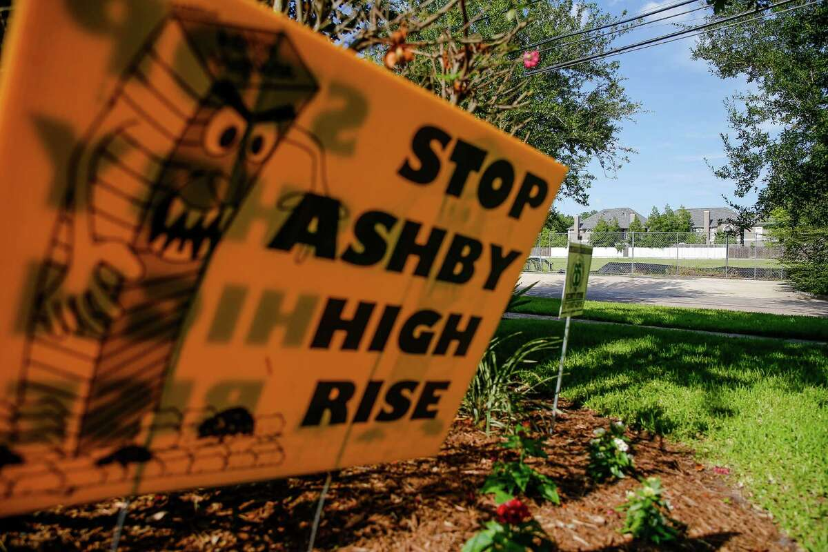 """A """"Stop Ashby High Rise"""" sits in the lawn of a home across the street from the proposed residential tower in a neighborhood near Rice University Friday, July 1, 2016 in Houston. A state appellate court has reversed a portion of the 2014 judgment that would have required developers of the high-rise to pay damages to residents in the neighborhood should they build the controversial residential tower. ( Michael Ciaglo / Houston Chronicle )"""