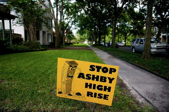 "A ""Stop Ashby High Rise"" sits in the lawn of a home near the proposed residential tower in a neighborhood near Rice University Friday, July 1, 2016 in Houston. A state appellate court has reversed a portion of the 2014 judgment that would have required developers of the high-rise to pay damages to residents in the neighborhood should they build the controversial residential tower. ( Michael Ciaglo / Houston Chronicle )"