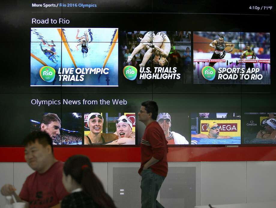 Comcast/NBC Olympic menus that show up on sports apps are also on display at the Comcast Silicon Valley Innovation Center in Sunnyvale. Photo: Liz Hafalia, The Chronicle