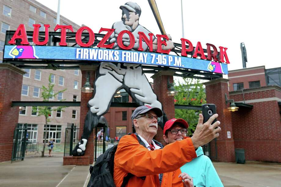 Marc (left) and Tracy Weiter, of St. Louis, Mo., take a selfie before the Memphis Redbirds and New Orleans Zephyrs baseball game at AutoZone Park Wednesday June 1, 2016 in Memphis, Tennessee. Photo: San Antonio Express-News / © 2016 San Antonio Express-News