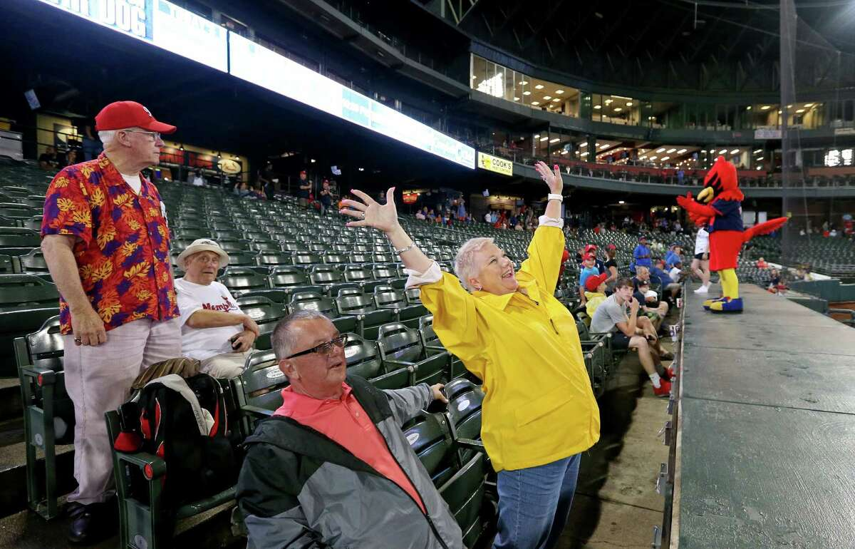 Fans enjoy the seventh-inning stretch during the Memphis Redbirds and New Orleans Zephyrs baseball game at AutoZone Park in Memphis, Tennessee. But a reader says the near empty stands illustrated that Triple-A teams are not as popular as some San Antonio officials would like us to believe.