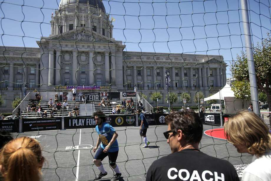 San Francisco's Mario Estrada (center) plays against Seattle at the 2014 Street Soccer USA tournament in Civic Center Plaza. Photo: Leah Millis, The Chronicle