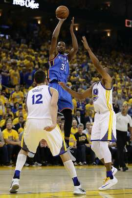 OAKLAND, CA - MAY 26:  Kevin Durant #35 of the Oklahoma City Thunder takes a shot against Andrew Bogut #12 and Andre Iguodala #9 of the Golden State Warriors during Game Five of the Western Conference Finals during the 2016 NBA Playoffs at ORACLE Arena on May 26, 2016 in Oakland, California.  (Photo by Ezra Shaw/Getty Images)