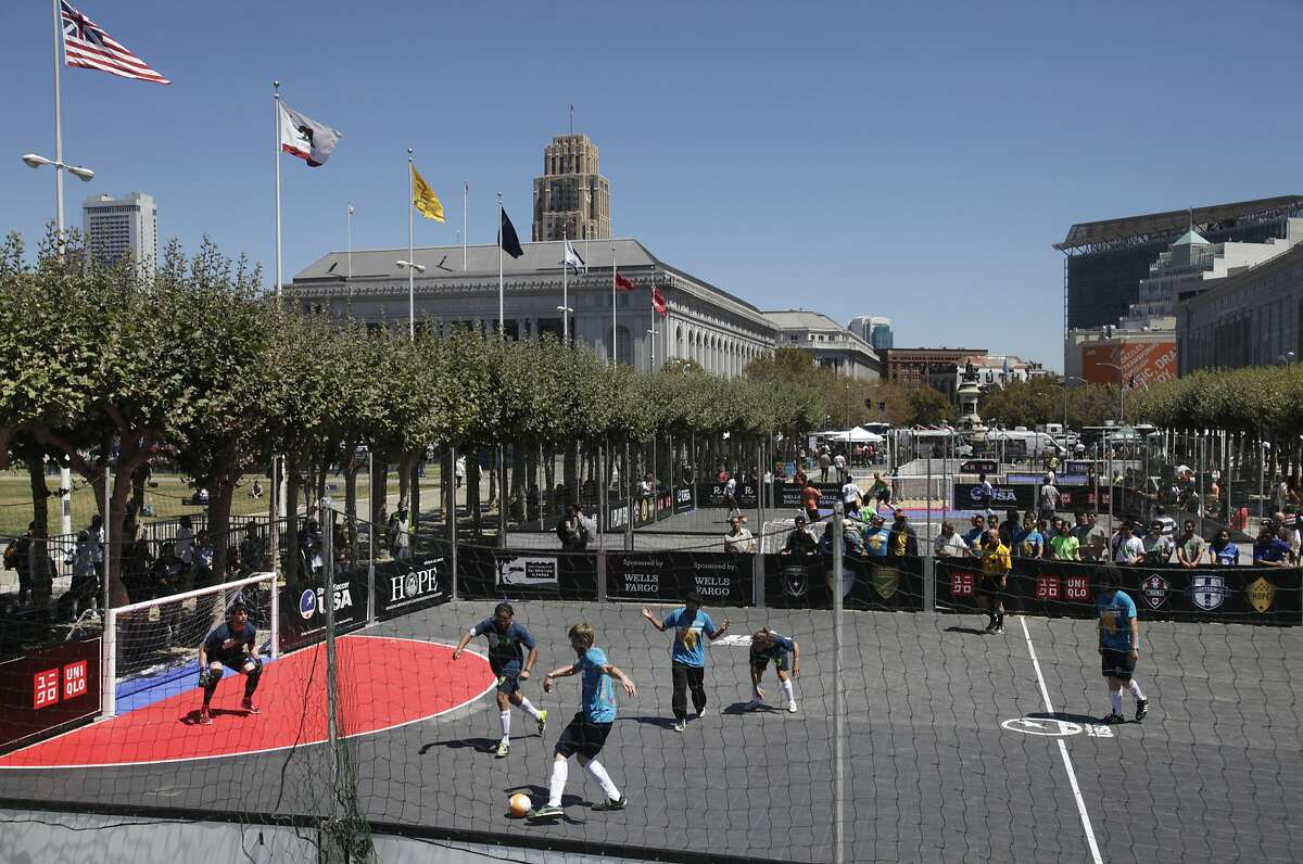 Members of Street Soccer San Francisco play against Seattle during the 2014 Street Soccer USA National Cup August 15, 2014 in Civic Center Plaza in San Francisco, Calif. The tournament features 4v4 street soccer from August 15th - 17th in Civic Center Plaza with 16 different cities competing for the cup and a spot on the roster for the 2014 Homeless World Cup.