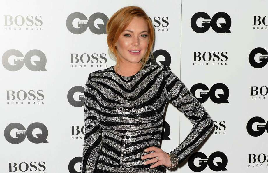 FILE- In this Sept. 2, 2012 file photo, Lindsay Lohan arrives for the GQ Men Of The Year Awards 2014 in central London. A Los Angeles judge on Wednesday Jan. 28, 2015, set another court hearing in Lohan's reckless driving case after a prosecutor questioned whether the actress had completed the terms of her community service sentence with a London charity organization. (Photo by Jonathan Short/Invision/AP, File) ORG XMIT: NYET310 Photo: Jonathan Short / Invision